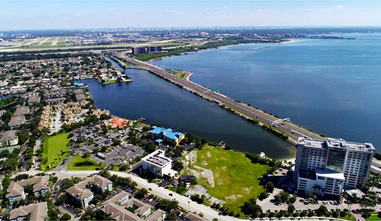 Rocky Point Represented the seller on the last remaining developable piece of vacant land on Rocky Point. The 3.08 acre waterfront property sold for $7,800,000 to Northwood Raven, who plan to build a nine story 180 unit apartment building.